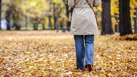 57920236 - lonely woman in a park in autumn