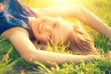 39523225 - beautiful young woman lying on the field in green grass